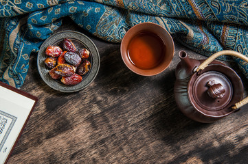 Ramadan of islam, date palm for Ramadan, date palm fruits and Tea on a metal tray placed on wood background.