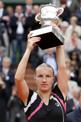 Kuznetsova holds up her trophy after winning women's final against Safina at the French Open tennis tournament in Paris