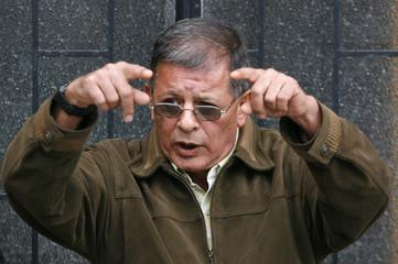 Colombian rebel leader Granda gestures during a news conference in Bogota