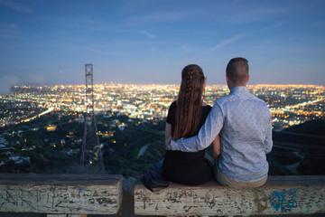 Rear view of couple looking away at view, Runyon Canyon, Los Angeles, California, USA