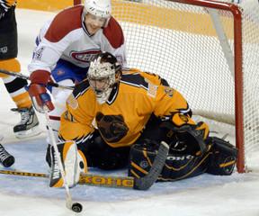 BRUINS GOALIE KEEPS PUCK OUT OF NET AGAINST CANADIENS PERREAULT.