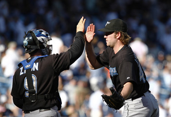 Blue Jays' Janssen and Zaun celebrate after defeating Yankees in New York