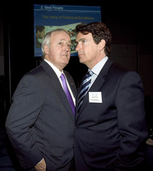 The Right Honourable Brian Mulroney, Chairman of Quebecor World Inc., speaks with Pierre Karl Peladeau, President and CEO of Quebecor Inc. following the annual general meeting of Quebecor World in Montreal