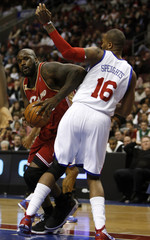 Cavaliers center O'Neal drives on the 76ers forward Speights in Philadelphia
