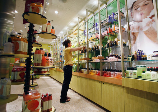 Meleta Smith cleans shelves at Fruits & Passion body and bath store in Calgary's International airport
