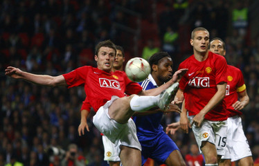 Manchester United's Michael Carrick clears the ball during their UEFA Champions League final at the Luzhniki stadium in Moscow