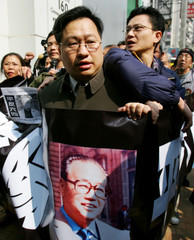 Pro-democracy activists carrying portrait of Zhao Ziyang take part in march in Hong Kong.