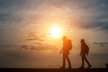 Silhouette of couple traveler.