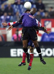 RACING CLUB LENS' NOUMA GOES FOR HIGH BALL DURING UEFA CUP MATCH AGAINST ATLETICO DE MADRID.