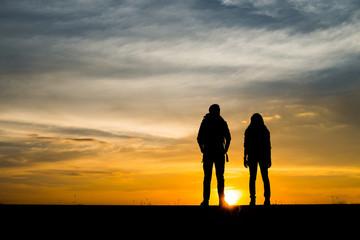 Silhouette of couple traveler.