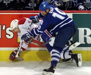 LEAFS VALK SENDS CANADIENS BRISEBOIS TO THE ICE.