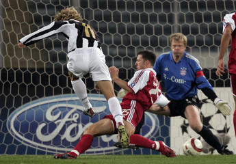 Juventus's Nedved scores against Bayern Munich during their Champions League match in Turin.