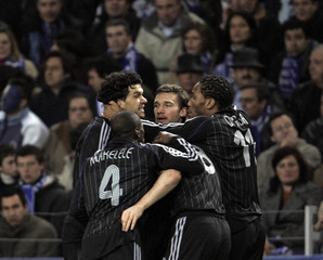 Chelsea's Shevchenko celebrates his goal against Porto with his team mates during their Champions League match in Porto