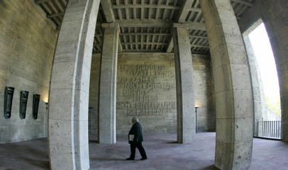 A visitor walks inside the Langemarckhalle (Langemarck hall) during the opening of the new documenta..