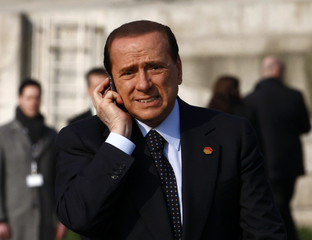 """Italy's Prime Minister Silvio Berlusconi crosses the """"Two Banks Bridge"""" on the Rhine river between the German city of Kehl and the French town of Strasbourg"""