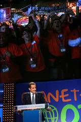 France's UMP political party presidential candidate Sarkozy addresses a political rally as he campaigns in Paris