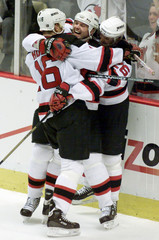 NEW JERSEY DEVILS PLAYERS CELEBRATE GOAL VERSUS MAPLE LEAFS IN GAME 3.