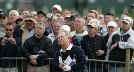 Nicklaus of US watches his drive from second tee during second day's play at British Open in St. Andrews.
