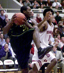 OREGON'S JONES PROTECTS BALL FROM STANFORDS CHILDRESS.