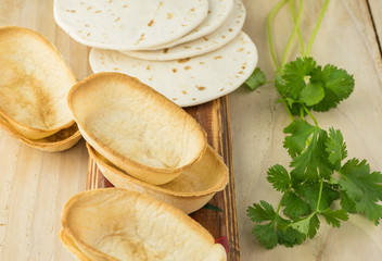 Flour tortillas and mini taco boats - ingredients for taco.