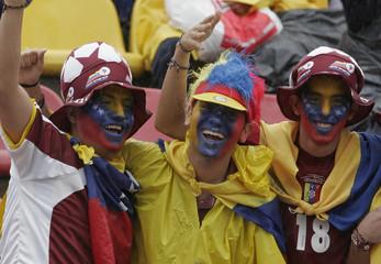 Soccer fans wear Venezuelan colors while awaiting Match 2 of the Copa America Venezuela 2007 soccer tournament in San Cristobal