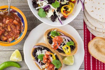 Mini taco boats with black beans and vegetables.