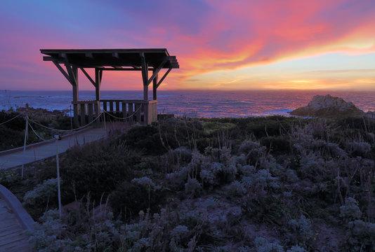 Sunset behind a public gazebo at Asilomar State Beach in California