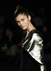 A model displays an outfit created by designer Miro during the Autumn/Winter 2006-07 Pasarela Cibeles fashion show in Madrid