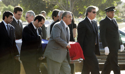 Gustavo Stroessner, son of former Paraguayan dictator Alfredo Stroessner, leads relatives and friends as they carry his father's coffin to be buried in a cemetery in Brasilia