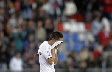 Valencia's Michel reacts after losing the match against Numancia during their Spanish First Division Soccer League in Soria