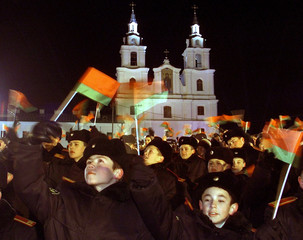 BELARUS CADETS WAVE NATIONAL FLAGS AS THEY SING THE NATIONAL ANTHEM INMINSK.