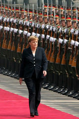 German Chancellor Angela Merkel reviews honor guard in Beijing