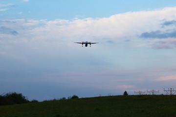 The plane lands at dusk