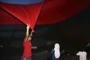 Supporters of the leftist National Sandinista National Liberation Front (FSLN) hold the party's flags in Managua.