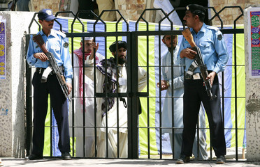 Policemen guard the gate of the Red Mosque, Islamabad