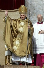 Pope Benedict XVI waves before his inaugural mass in St. Peter's Square in the Vatican.
