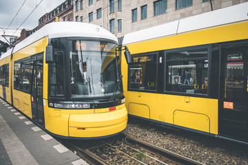 Berlin city tram, electric train on the street at Warschauerstr. in Berlin