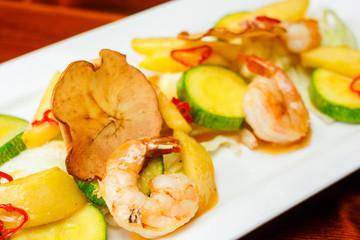 Hot prawn salad with potatoes
