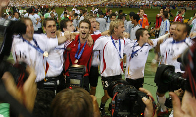 Germany players celebrate after their World Cup 2006 third place soccer match against Portugal in Stuttgart
