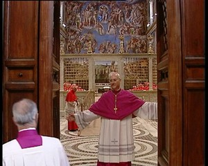 Archbishop Piero Marini closes the door to the Sistine Chapel in Vatican City.