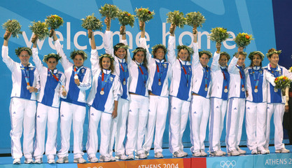 Greece team celebrate silver medal placing in womens Olympic water polo gold medal match in Athens.
