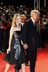 """U.S. actor Harrison Ford and partner actress Calista Flockhart arrive for the screening of the film """"The Proposal"""" at the 35th Deauville American film festival"""
