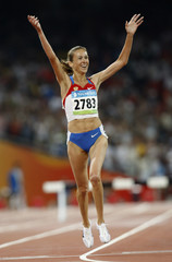 Galkina-Samitova of Russia celebrates winning the women's 300m steeplechase final  at the Beijing 2008 Olympic Games