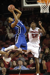 University of Memphis' Rodney Carney goes overtop University of Louisville's Otis George.