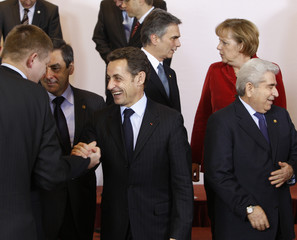 France's President Sarkozy poses with EU leaders during a family photo at a two-day European Union leaders summit in Brussels
