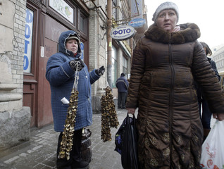 A woman sells dried mushrooms on a street in central St Petersburg