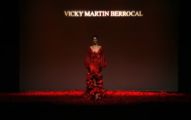 A model presents a creation from Vicky Martin Berrocal during the International Flamenco Fashion Show in Seville