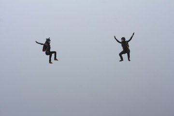 Two skydiver girls in the cloud