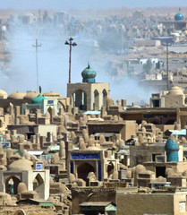 A CLOUD OF BLUE SMOKE COVERS ANCIENT CEMETERY, FOLLOWING AN EXPLOSION IN NAJAF.