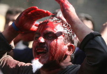 A Shi'ite Muslim beats himself during an Ashura procession in New Delhi